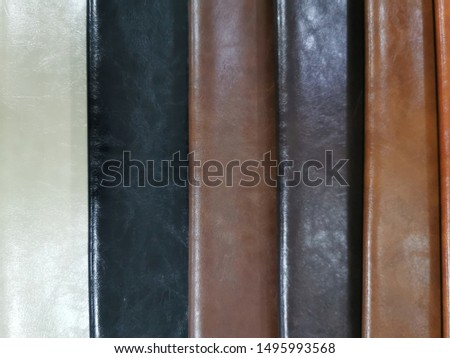 Upholstery sample materials with different shades and colors for manufacturing sofa, couches and beds.  #1495993568