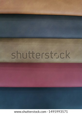 Upholstery sample materials with different shades and colors for manufacturing sofa, couches and beds.  #1495993571