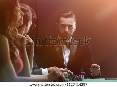 Upper class friends gambling in a casino