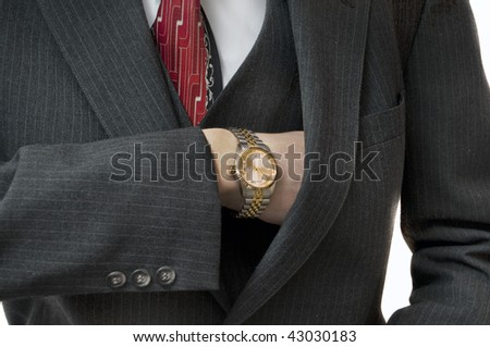 Upper class man reaching in pocket for checkbook with gold watch