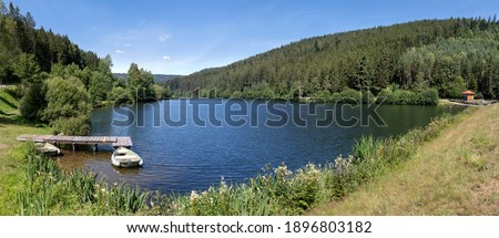 Upper lake of the Nagoldtalsperre in the Black Forest, Germany with boat at the wooden jetty, taken on the middle levee Stock fotó ©