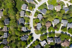 upper middle class american neighborhood with curving street in the east coast aerial view panorama