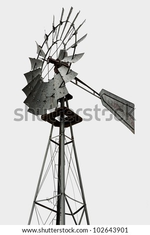 Upper part of a windmill for water pumping over white