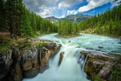 Upper Sunwapta Falls in Jasper National Park, Canada. The water originates from the Athabasca Glacier. Long exposure.