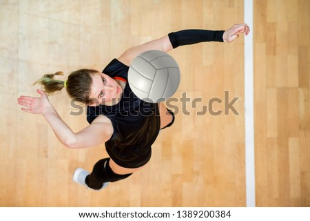 Photo of  Upper View of Female Volleyball Player at Service