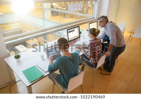 Upper view of students in class working on computers