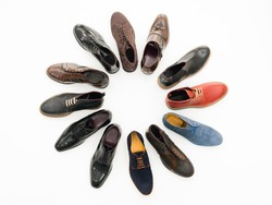 upper view, variety of male shoes arranged in circle, isolated on white background