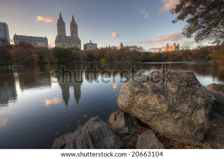 Upper West side of Manhattan as seen from Central Park in front of large boulder