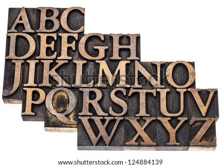 uppercase English alphabet in vintage letterpress wood type printing blocks, isolated on white