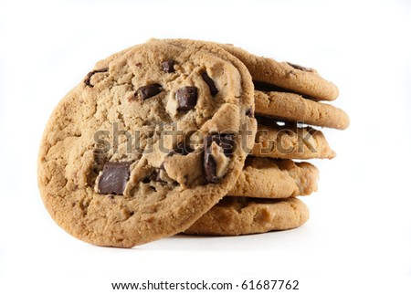 Upright cookies against a stack of chocolate chip cookies on a white isolated background