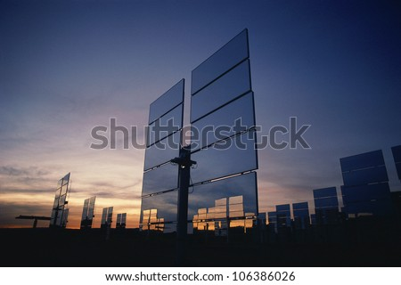 Upright solar panels at dusk - stock photo