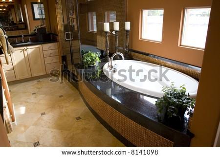 Upscale bathroom with a modern tub and tile floor.