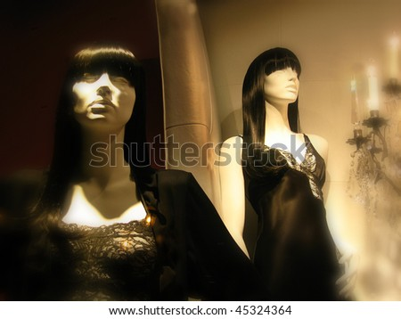 Upscale boutique display of mannequins in sleepwear. Soft focus borders for ambiance.