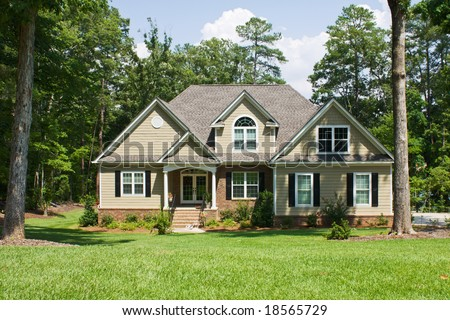 upscale home with brick, vinyl, and shake siding