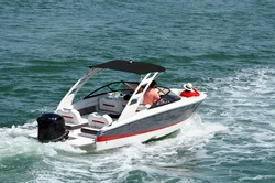 Upscale motorboat powered by an outboard engine.