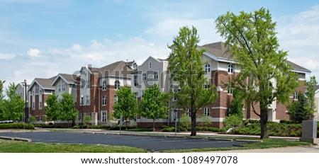 Upscale Red Brick & Tan Apartment Buildings