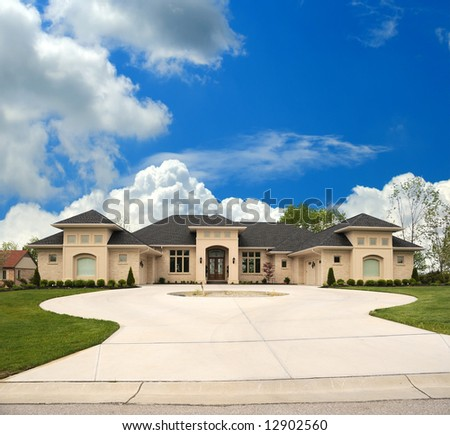 Upscale Tan Brick Suburban Home with a Circle Drive
