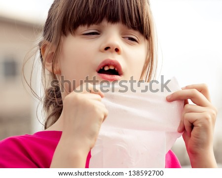 Upset  6 aged girl checking her  milky teeth. My first encounter with the tooth fairy