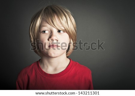 Upset boy looking left