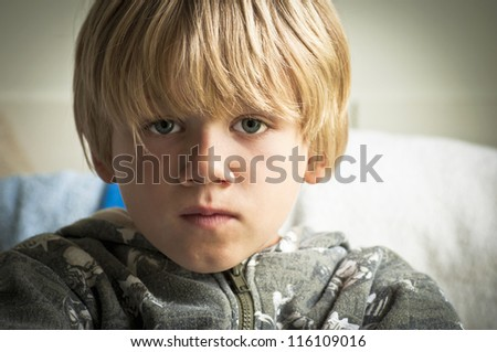 Upset boy with sad eyes