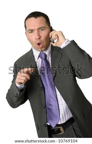 Upset businessman on his cellphone.