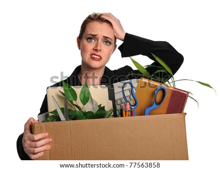Upset businesswoman carrying office belongings after loosing job
