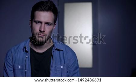 Upset drugs addict looking at camera, rehabilitation center, addiction treatment #1492486691