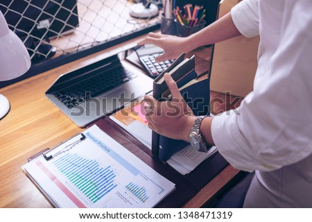 Upset female employee packing belongings in box, frustrated stressed girl getting fired from job ready to leave on last day at work. sad office worker desperate from work