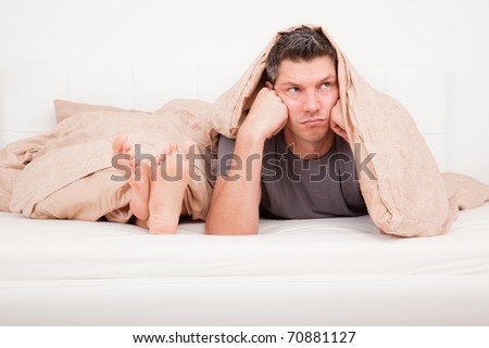 Upset frustrated and bored couple lying in bed having no sex