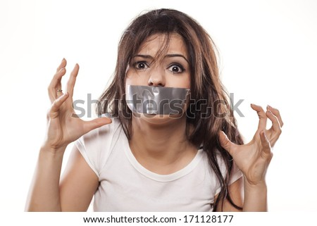 upset girl with self-adhesive tape over her mouth