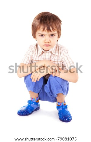 Upset little boy on white background