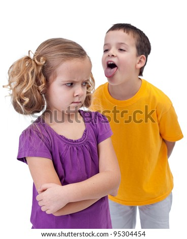 Upset little girl bullied and mocked by older boy - isolated