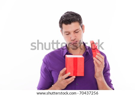 Upset man because of unhappy boring present