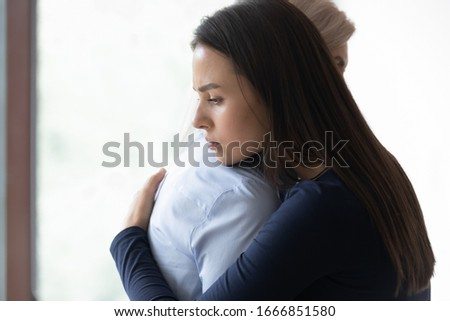 Upset millennial girl hug senior mom seek for help support, mature mother and sad adult grown-up daughter embrace, show care and love, parental understanding, good family relationship concept