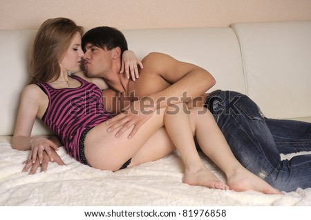 Upset pair of lovers lying on the bed. Family conflict. - stock photo
