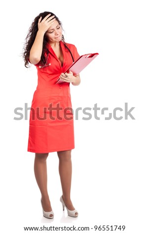 Upset professional young nurse or medical woman  doctor with big breasts, wearing tangerine tango orange uniform dress ,with clipboard.  Full body isolated on white background