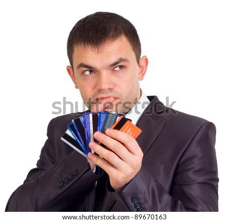 Upset Robed man Glaring At his Many Credit Cards.