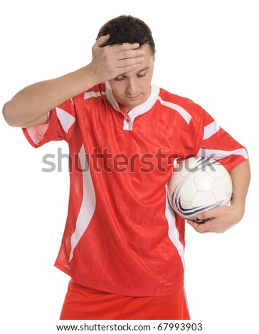 Upset soccer player in the red form. Isolated on white background