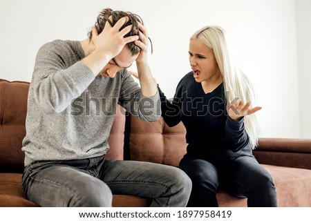 upset thoughtful husband thinking about relationship problems, wife ignoring after quarrel, angry man and woman not talking, sitting separately on couch, family crisis conflict concept Stock photo ©
