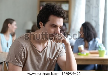 Upset thoughtful man sitting alone, low self-esteem, have no friends, feeling depressed, outsider, Upset mixed race woman offended by friends, feeling unhappy concept, suffering from bullyin
