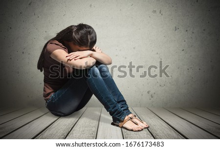 Upset woman frustrated by problem sitting on the floor