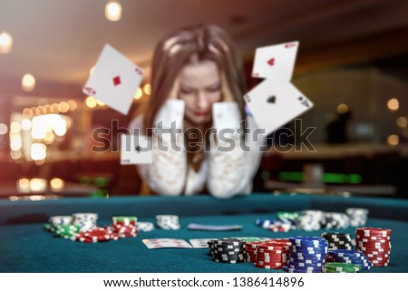 Upset woman in casino with falling cards #1386414896