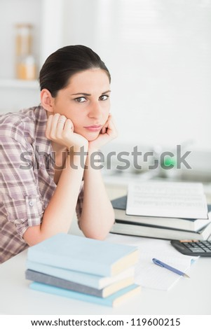 Upset woman working in a living room