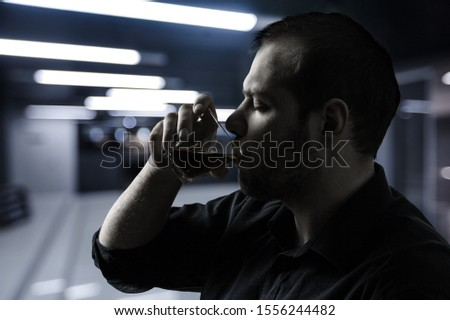 Upset young man drinker alcoholic sitting at bar counter with glass drinking whiskey alone, sad depressed addicted drunk guy having problem suffer from alcohol addiction abuse, alcoholism concept #1556244482
