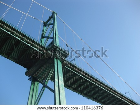 Upshot of Lionsgate bridge from the seawall on a clear day, Vancouver.