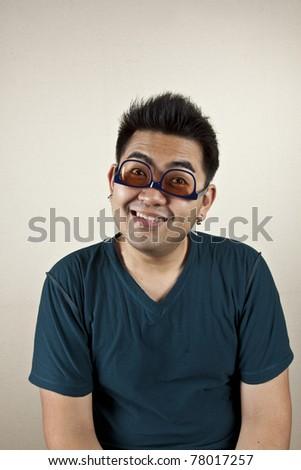 upside down, A man wearing eyeglass upside down, funny face.