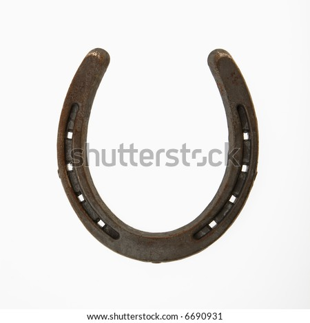 Upside down horseshoe against white background.