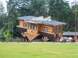 Upside Down House in Szymbark Poland. It stands on its roof and visitors walk on the ceilings and it is decorated in the socialist style of the 1970s.
