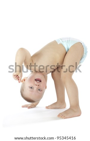 Upside down standing baby (isolated on white) - stock photo
