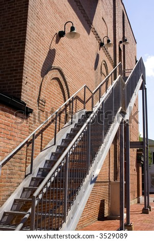 Upstairs Exterior Stage Door at the Top of a Metal Staircase.